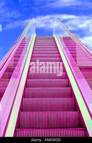 Computer enhanced escalator moving up to blue sky - Stock Photo