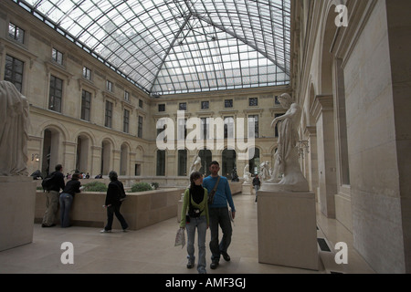 young couple in gallery of classical sculpture louvre museum paris france - Stock Photo