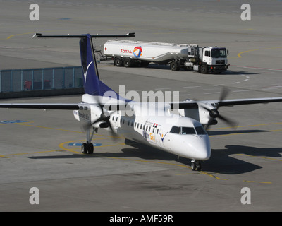 InterSky Bombardier Dash 8-Q300 on the ramp with fuel bowser - Stock Photo