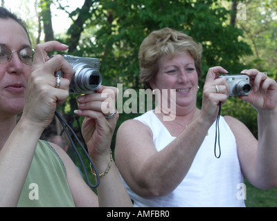 Women Taking Digital  Pictures - Stock Photo