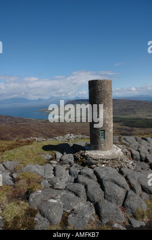 Trig point at the summit of An Sgurr on the island of Eigg, Scotland, UK - Stock Photo