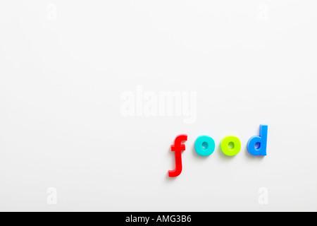 kids alphabet fridge magnets spelling food - Stock Photo