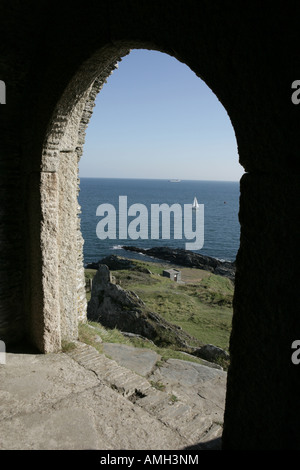 Looking out to sea from Queen Adelaide's Grotto at Penlee Point on he Rame Peninsula Cornwall once used by smugglers - Stock Photo