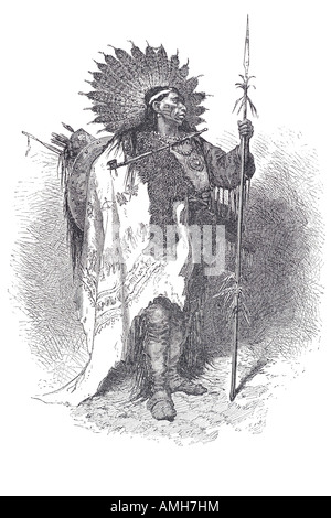 chief full war dress north American Indian headdress spear traditional costume native dress pipe arrow bow moccasin - Stock Photo