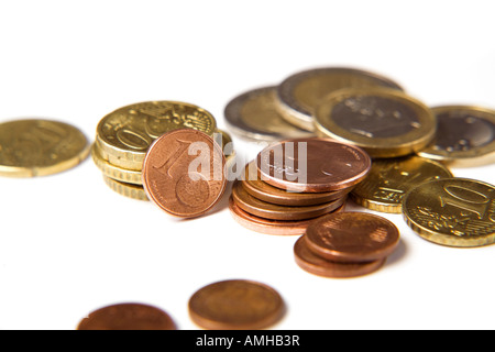close-up of various european currency coins on white background - Stock Photo