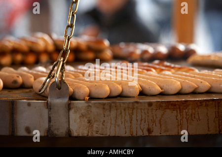 rostbratwurst bratwurst sausages cooking on schwenkgrill christmas market Berlin Germany - Stock Photo