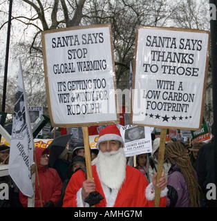 Protestors placards Climate Change march London December 8th 2007 - Stock Photo