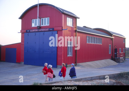 Group of women chatting outside Caister on Sea lifeboat station Norfolk England - Stock Photo