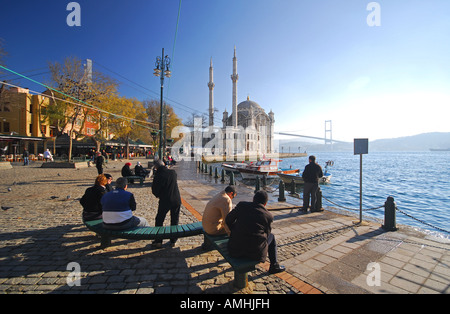 ISTANBUL, TURKEY. The Bosphorus waterfront at Ortakoy, with the Mecidiye Mosque and first Bosphorus bridge behind. - Stock Photo