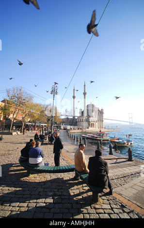 ISTANBUL The Bosphorus waterfront at Ortakoy in Besiktas district, with the Mecidiye Mosque & first Bosphorus bridge - Stock Photo