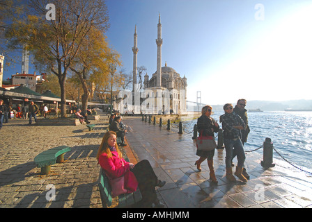 ISTANBUL, TURKEY. View of the Bosphorus waterfront at Ortakoy, with the Mecidiye Mosque and first Bosphorus bridge - Stock Photo