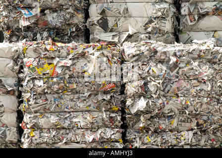 Bundles of returned newspapers at paper recycling facility England UK - Stock Photo
