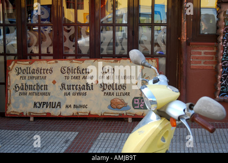 characteristic restaurant front with moped Calella Spain - Stock Photo