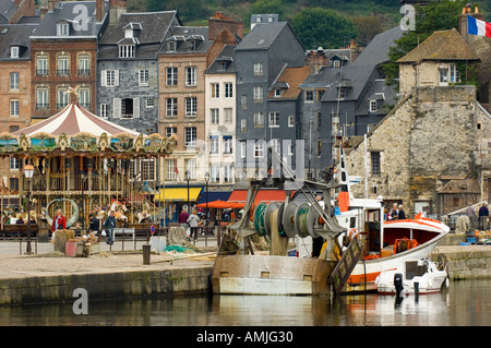 Vieux Bassin the old dock and La Lieutenance the 16C lieutenant s house and carousel at Honfleur in Normandy France - Stock Photo