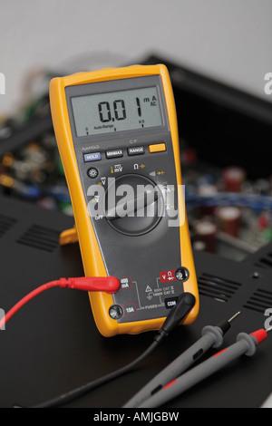 Electric meter digital multimeter - Stock Photo