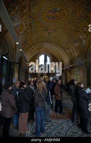 tourists inside the Gedenkhalle memorial hall of Kaiser Wilhelm Gedächtniskirche memorial church Berlin Germany - Stock Photo