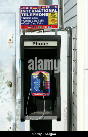 Public international credit card telephone booth Gustavia St Barts - Stock Photo