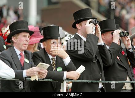 Men looking through binoculars at Royal Ascot horse race, York, Great Britain - Stock Photo