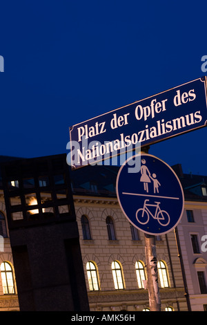 A sign reading 'Platz der Opfer des Nationalsozialismus' meaning 'place of the victims of Nationalsocialism'. - Stock Photo