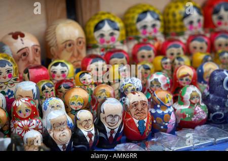 soviet and russian matryoshka dolls on sale on a street stall - Stock Photo