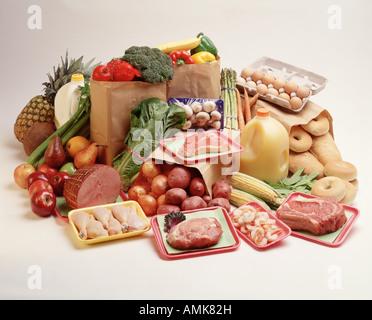 basic food groups fruit vegetable meat poultry dairy grocery items chicken steak milk eggs ham potato bagel bread - Stock Photo