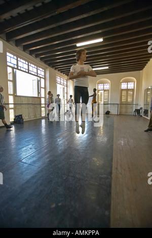 Male dancer jumping into air at Pro Danza Ballet dance studio and school Cuba - Stock Photo
