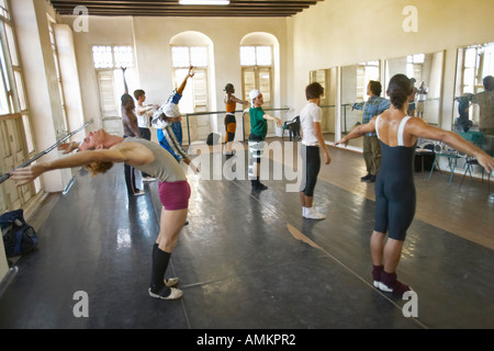 Male dancers stretching and exercising at Pro Danza Ballet dance studio and school Cuba - Stock Photo