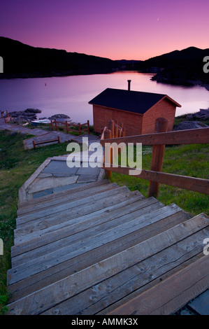 Steps leading down towards a shed at a picnic reserve during sunset in the town of Fleur de Lys, Newfoundland Labrador, - Stock Photo