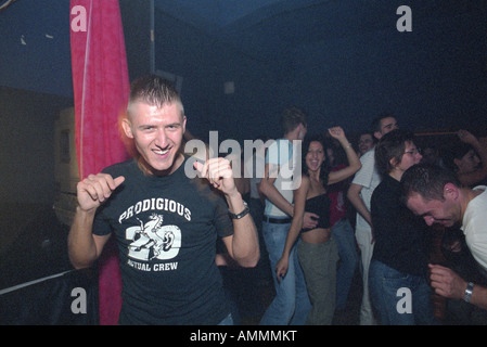 A young man dancing in the Sfera Club, Poznan, Poland - Stock Photo