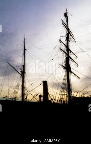 Silhouette of the RRS Discovery research ship at sunset in Dundee,UK - Stock Photo