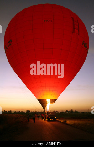 Hot Air Balloon Firing at Sunset before Lift Off [River Nile, Near Luxor, Egypt, Arab States, Africa].          - Stock Photo