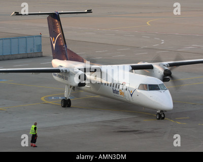 Short haul air travel. InterSky Bombardier Dash 8-Q300 propeller powered passenger plane starting up at Cologne/Bonn - Stock Photo
