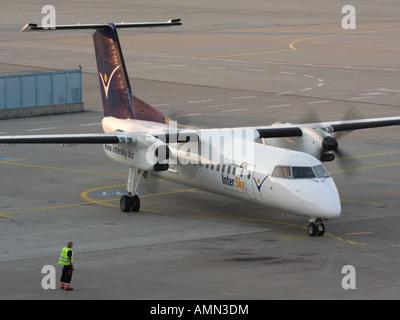 Short haul air travel. InterSky Bombardier Dash 8-Q300 turboprop passenger plane starting up at Cologne/Bonn Airport - Stock Photo