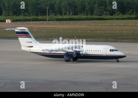 Avro RJ100 operated by Flightline taxiing at Cologne/Bonn Airport Germany - Stock Photo