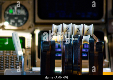 Engine Throttle in the Cockpit of a 747 Boeing Commercial Jet Airplane - Stock Photo