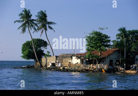 Oruvas boat sailing along the coast at Negombo - Stock Photo