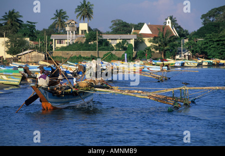 old Oruvas boat coming into Negombo harbor - Stock Photo