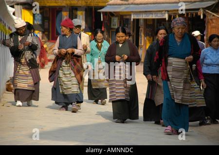 Tibetan women in traditional dress Bodhnath Stupa Kathmandu Nepal - Stock Photo