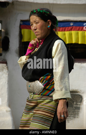 Tibetan woman in traditional dress Bodhnath Stupa Kathmandu Nepal - Stock Photo