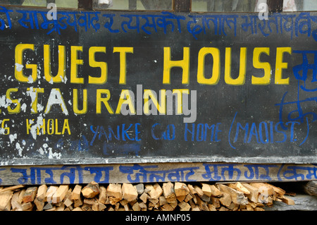Sign Guest House with graffity of the rebels Maos Maoists Annapurna Region Nepal - Stock Photo