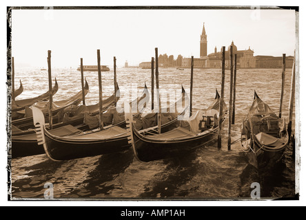 Gondolas in the early morning sun Venice Italy
