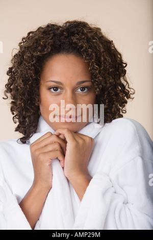 African woman wearing bathrobe - Stock Photo