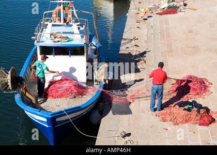 dh  BOSA SARDINIA Fisherman quayside fishing boat nets - Stock Photo