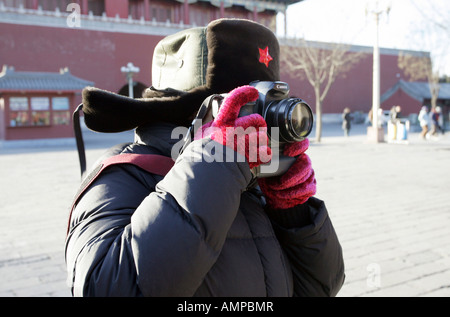 Tourist taking pictures in the Forbidden City, Beijing, China - Stock Photo