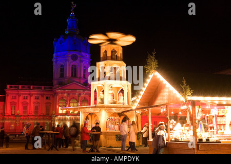 Christmas market in front of the illuminated Charlottenburg Palace the summer residence of the Prussian kings built - Stock Photo