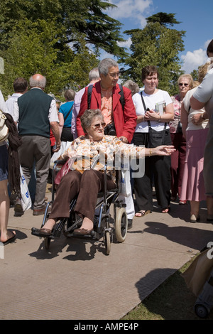 disabled woman in a wheelchair at the Hampton Court Flower Show UK - Stock Photo