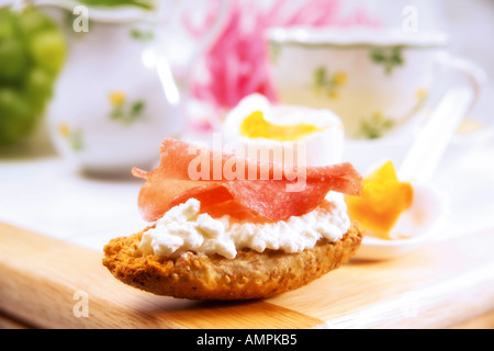 Crispbread with cottage cheese and sausage - Stock Photo