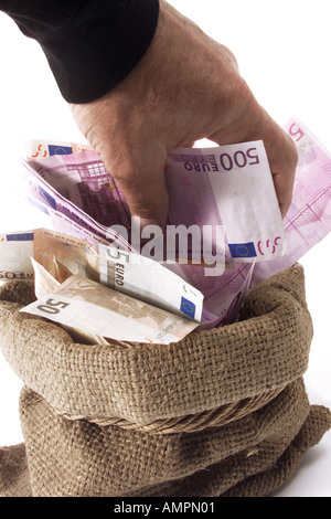 Man taking money from sack