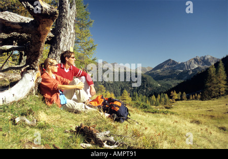 Couple having a break in the moutains - Stock Photo