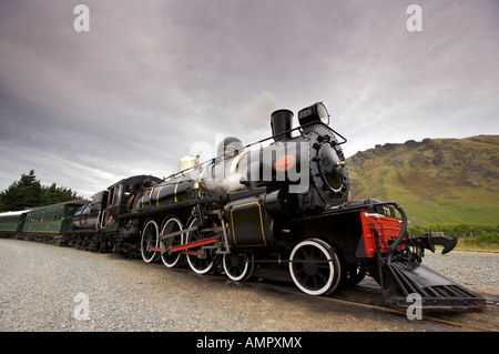 Kingston Flyer, a steam train built in 1925, at the Fairlight Station in Central Otago, South Island, New Zealand. - Stock Photo